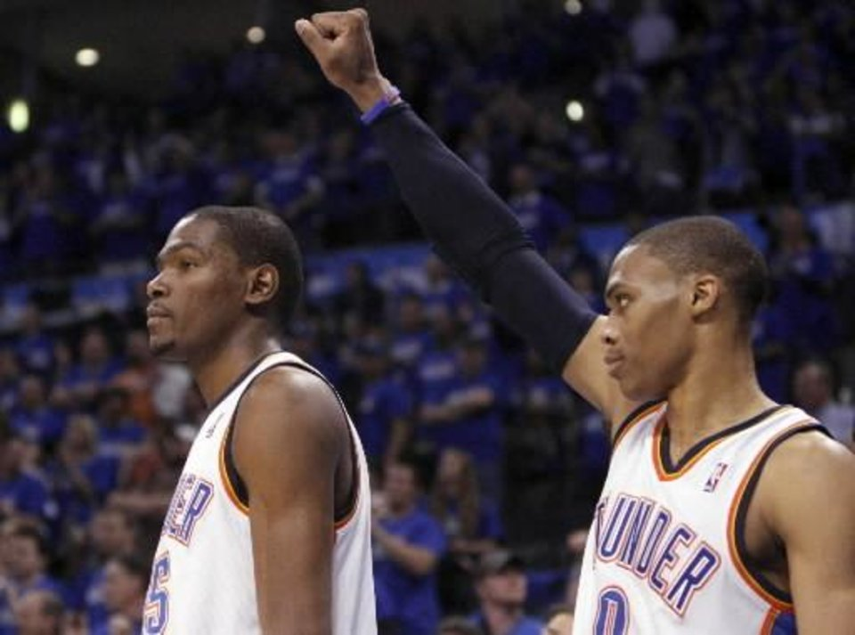 Photo - Oklahoma City's Kevin Durant (35) and Russell Westbrook (0) celebrate during the first round NBA basketball playoff game between the Oklahoma City Thunder and the Denver Nuggets on Saturday, April 20, 2011, at the Oklahoma City Arena. Photo by Sarah Phipps, The Oklahoman