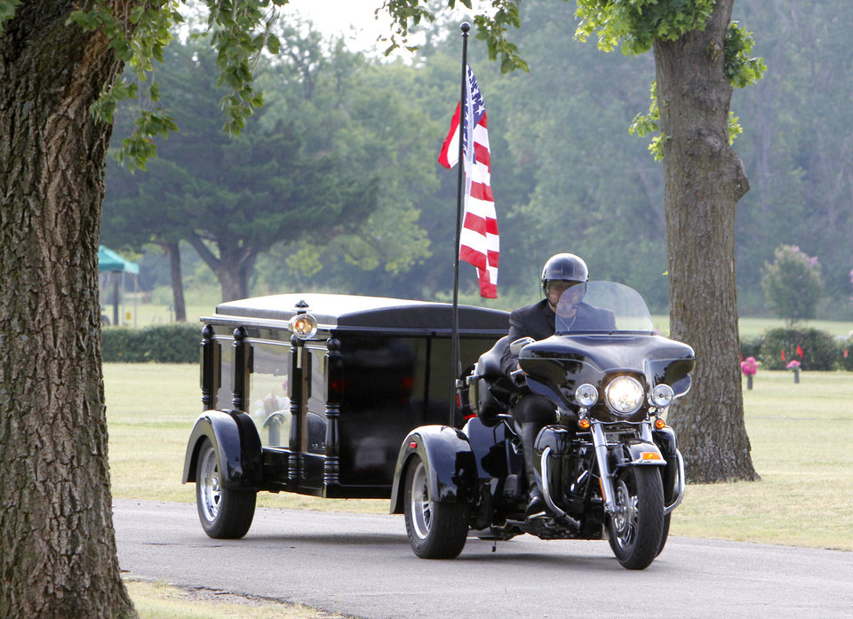 Photo - Brian Gray, who runs a motorcycle hearse business called Final Ride, demonstrates his service at Chapel Hill Memorial Gardens Cemetery in Oklahoma City, OK, Tuesday, July 10, 2012,  By Paul Hellstern, The Oklahoman