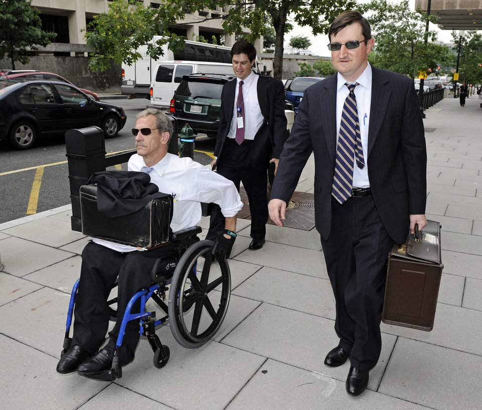 Photo -   FILE - In this July 13,2011 file photo, Assistant U.S. Attorneys Daniel Butler, left, and Steve Durham, leave federal court in Washington. On a baseball field, players back up teammates to limit the damage from errors. The Justice Department, embarrassed by an error that caused a mistrial of Roger Clemens last year, has added more prosecutors in hopes of containing any missteps as it seeks to convict the famed pitcher of lying to Congress when he said he never used performance-enhancing drugs. (AP Photo/Cliff Owen, File)