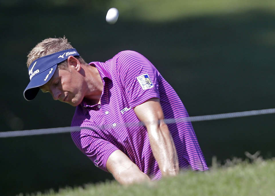 Photo - Luke Donald hits onto the 8th green during a practice round for The Players championship golf tournament at TPC Sawgrass in Ponte Vedra Beach, Fla., Wednesday, May 7, 2014. (AP Photo/Gerald Herbert)
