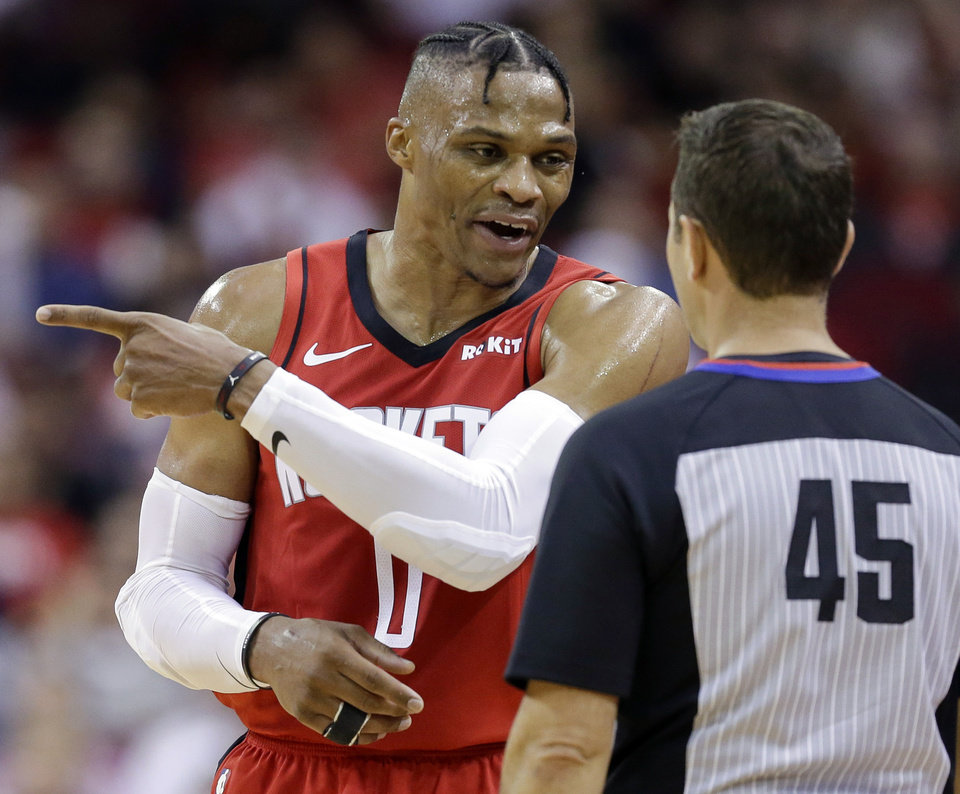 Photo - Houston Rockets guard Russell Westbrook, left, talks with referee Brian Forte after being assessed a technical foul during the second half of an NBA basketball game against the Oklahoma City Thunder, Monday, Oct. 28, 2019, in Houston. (AP Photo/Eric Christian Smith)