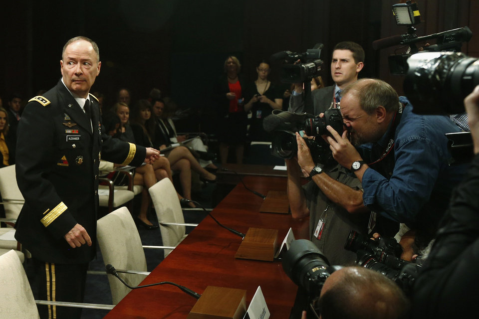 Photo - National Security Agency (NSA) Director Gen. Keith B. Alexander approaches the witness table on Capitol Hill in Washington, Tuesday, June 18, 2013,  to testify before the House Intelligence Committee hearing regarding NSA surveillance. (AP Photo/Charles Dharapak)