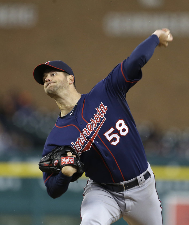 Photo - Minnesota Twins starting pitcher Scott Diamond throws during the second inning of a baseball game against the Detroit Tigers in Detroit, Thursday, May 23, 2013. (AP Photo/Carlos Osorio)