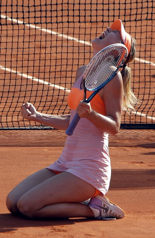 Photo - Russia's Maria Sharapova reacts after defeating Romania's Simona Halep in their final match of  the French Open tennis tournament at the Roland Garros stadium, in Paris, France, Saturday, June 7, 2014. (AP Photo/Thibault Camus)