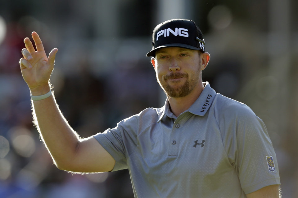 Photo - Hunter Mahan waves to fans as he finishes on the 18th hole during the final round of play at The Barclays golf tournament Sunday, Aug. 24, 2014, in Paramus, N.J. Mahan won the tournament. (AP Photo/Mel Evans)
