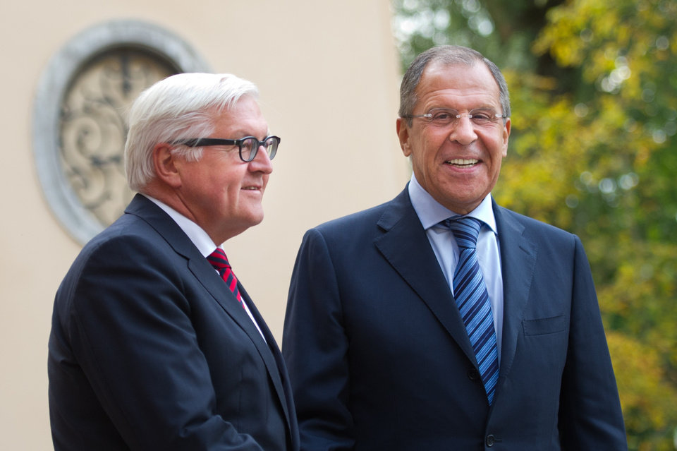 Photo - German Foreign Minister Frank-Walter Steinmeier, left, welcomes his Russian counterpart Sergey Lavrov before a meeting at the Guesthouse of the Foreign Ministry Villa Borsig in Berlin, Sunday, Aug. 17, 2014. (AP Photo/Steffi Loos)