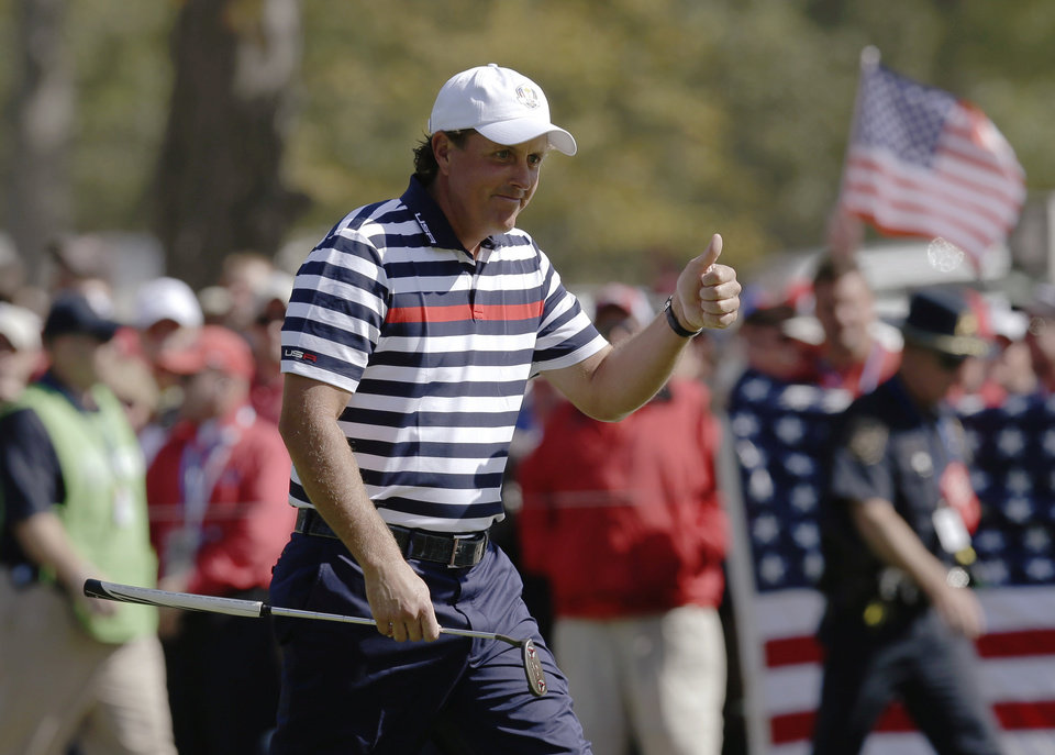 USA's Phil Mickelson gives a thumbs up as he walks up the third hole during a singles match at the Ryder Cup PGA golf tournament Sunday, Sept. 30, 2012, at the Medinah Country Club in Medinah, Ill. (AP Photo/David J. Phillip)  ORG XMIT: PGA122