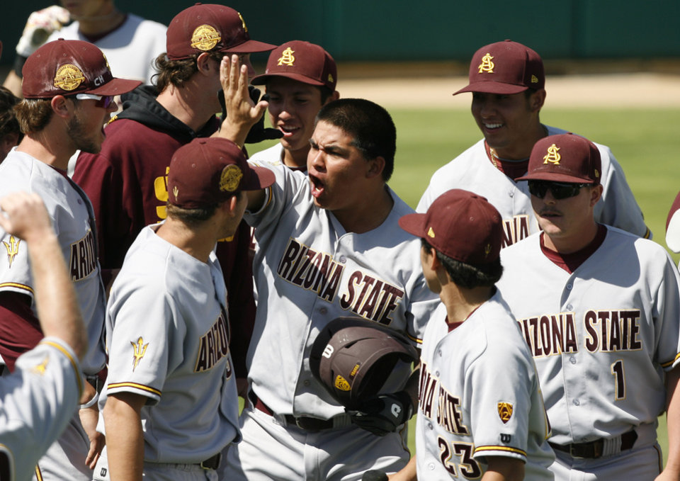 Photo - Arizona State's RJ Ybarra is congratulated by teammates after hitting a two-run home run in the ninth inning of an NCAA college baseball tournament regional game against Sacramento State on Saturday, May 31, 2014, in San Luis Obispo, Calif. (AP Photo/Aaron Lambert)