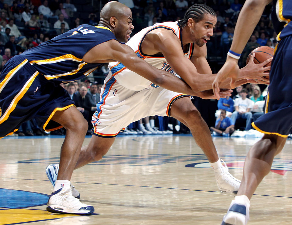 Photo - Oklahoma City's Thabo Sefolosha is pressured by Indiana's Jarrett Jack (left) and other defenders during the NBA basketball game between the Indiana Pacers and the Oklahoma City Thunder at the Ford Center in Oklahoma City, Sunday, April 5, 2009. The Thunder lost 117 to 99. Photo by John Clanton, The Oklahoman