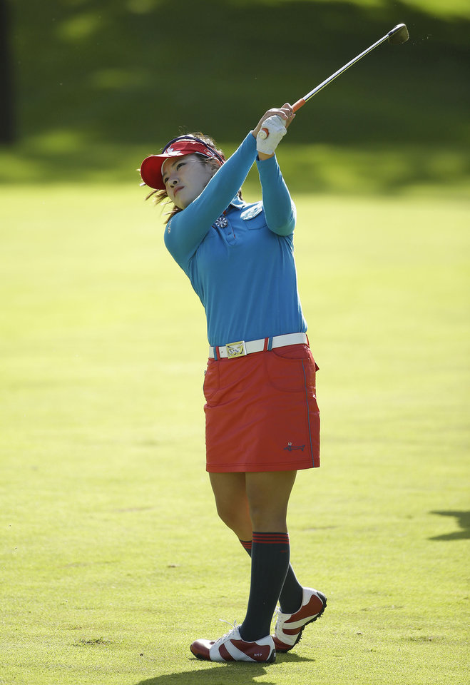 Photo - Hee Young Park, of South Korea, hits up to the 18th green of the Lake Merced Golf Club during the third round of the Swinging Skirts LPGA Classic golf tournament on Saturday, April 26, 2014, in Daly City, Calif. (AP Photo/Eric Risberg)