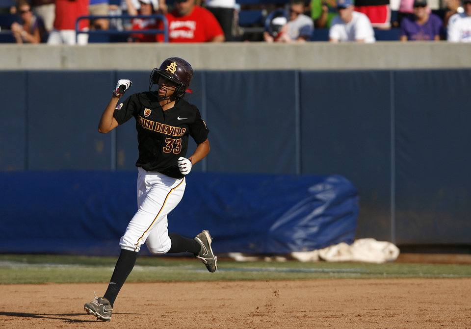 Arizona State's Alix Johnson (33) reacts while running bases after hitting a home run during a Women's College World Series game between Arizona State and LSU at ASA Hall of Fame Stadium in Oklahoma City, Saturday, June 2, 2012. Photo by Garett Fisbeck, The Oklahoman