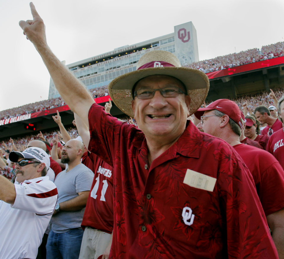 Gary Parks, Moore, raises his hand before the college football game between OU and Tulsa on Saturday, Sept. 3, 2011, in Norman.  Photo by Steve Sisney, The Oklahoman