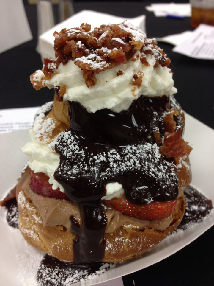 Photo - This Giant Cream Puff from CocoFlow took second in Best Tasting Sweet in the A Great Taste of a Fair contest at State Fairgrounds on Wednesday.  DAVE CATHEY - THE OKLAHOMAN