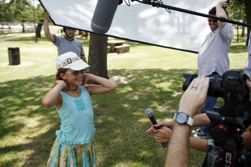 Photo - Vivienne Harr, 9, of Fairfax, Calif., is interviewed Friday in Woodland Park in Shawnee. Photo by Aliki Dyer, The Oklahoman  Aliki Dyer - The Oklahoman