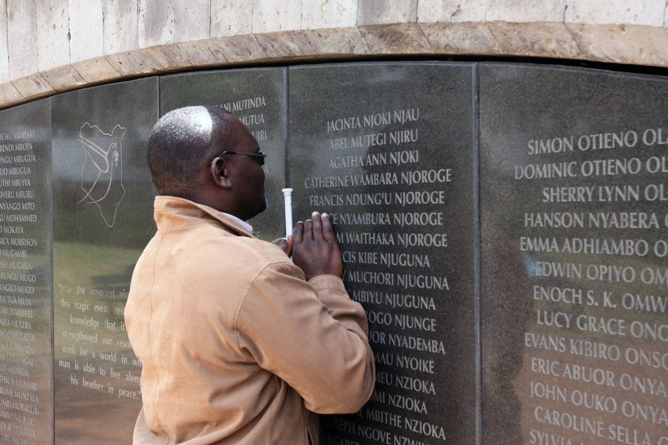 Photo - Douglas Sidialo, who lost his sight in the 1998 bombing of the U.S. embassy in Nairobi pray at the memorial remembering the victims in Nairobi, Kenya, Monday, May 2. 2011. Bin Laden, the glowering mastermind behind the Sept. 11, 2001, terror attacks that killed thousands of people, was slain in his hideout in Pakistan early Monday in a firefight with U.S. forces, ending a manhunt that spanned a frustrating decade. (AP Photo/Khalil Senosi)