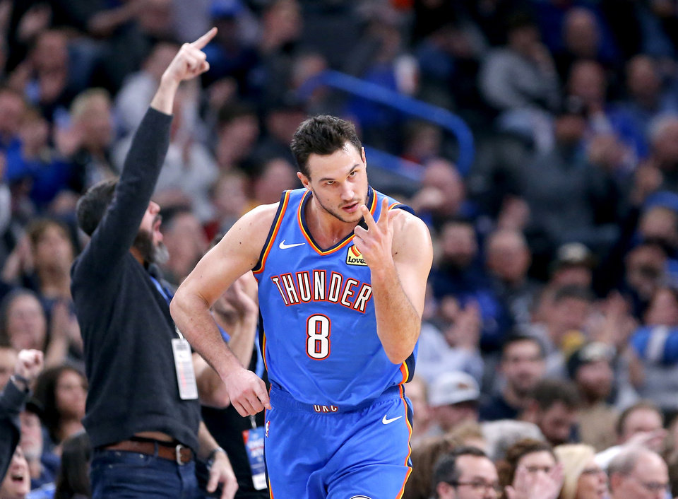 Photo - Oklahoma City's Danilo Gallinari (8) celebrates a 3-point basket during the NBA basketball game between the Oklahoma City Thunder and the Atlanta Hawks at the Chesapeake Energy Arena in Oklahoma City,Friday, Jan. 24, 2020.  [Sarah Phipps/The Oklahoman]