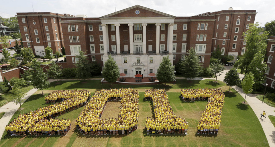 Photo -  One late student, right, runs to join the freshmen class at Vanderbilt University as they spell out 2017, their graduation year, for a photo on the campus on Tuesday, Aug. 20, 2013, in Nashville, Tenn. Classes begin Wednesday. (AP Photo/Mark Humphrey)