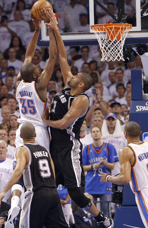 Oklahoma City's Kevin Durant (35) battles to the basket against San Antonio's Tim Duncan (21) during Game 6 of the Western Conference Finals between the Oklahoma City Thunder and the San Antonio Spurs in the NBA playoffs at the Chesapeake Energy Arena in Oklahoma City, Wednesday, June 6, 2012. Photo by Chris Landsberger, The Oklahoman
