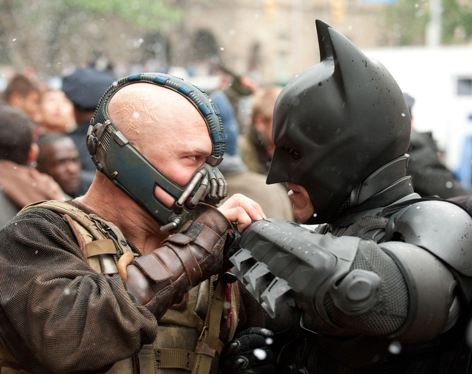 Photo - From left, Tom Hardy plays Bane and Christian Bale Batman in Warner Bros. Pictures' and Legendary Pictures' action-thriller