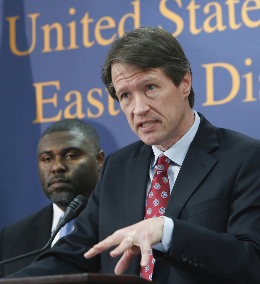 Photo - Benjamin Wagner, the United States Attorney for the Eastern District of California, discusses the federal crackdown on the surge of thefts from mailboxes across the Central Valley, during a news conference in Sacramento, Calif.,  Wednesday, Jan. 15, 2014.  Working with postal investigators and local law enforcement, at least 27 people have been charged with crimes related to the break-in of mailboxes in post offices lobbies, neighborhood mailboxes, postal trucks and the counterfeiting of postal keys in search of checks, credit cards, personal identifying information and prescription drugs deviled by mail.  At left is Dr. Gregory Campbell Jr, deputy chief inspector for Western Field Operations.(AP Photo/Rich Pedroncelli)