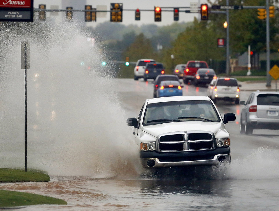 A truck splashes through rushing water on Western Avenue, between NW 63 and Wilshire. Strong thunderstorms, producing heavy downpours and lightning moved through the Oklahoma City area  during the morning and early afternoon hours on Saturday, Oct. 13, 2012. Overcast skies and intermittent rain continued throughout the day.    Photo by Jim Beckel, The Oklahoman