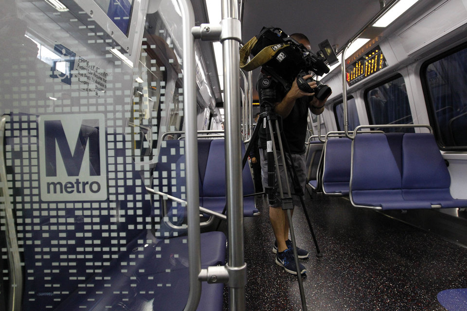 Members of the media and Washington Metropolitan Area Transit Authority tour a full-scale mock-up model of Metro's new generation 7000-series railcar after it was unveiled in Landover, Md., Wednesday, Oct. 10, 2012. (AP Photo/Ann Heisenfelt)