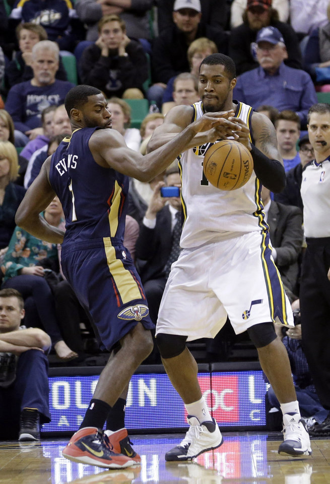 Photo - New Orleans Pelicans' Tyreke Evans, left, knocks the ball away from Utah Jazz's Derrick Favors, right, in the second quarter during an NBA basketball game on Friday, April 4, 2014, in Salt Lake City. (AP Photo/Rick Bowmer)