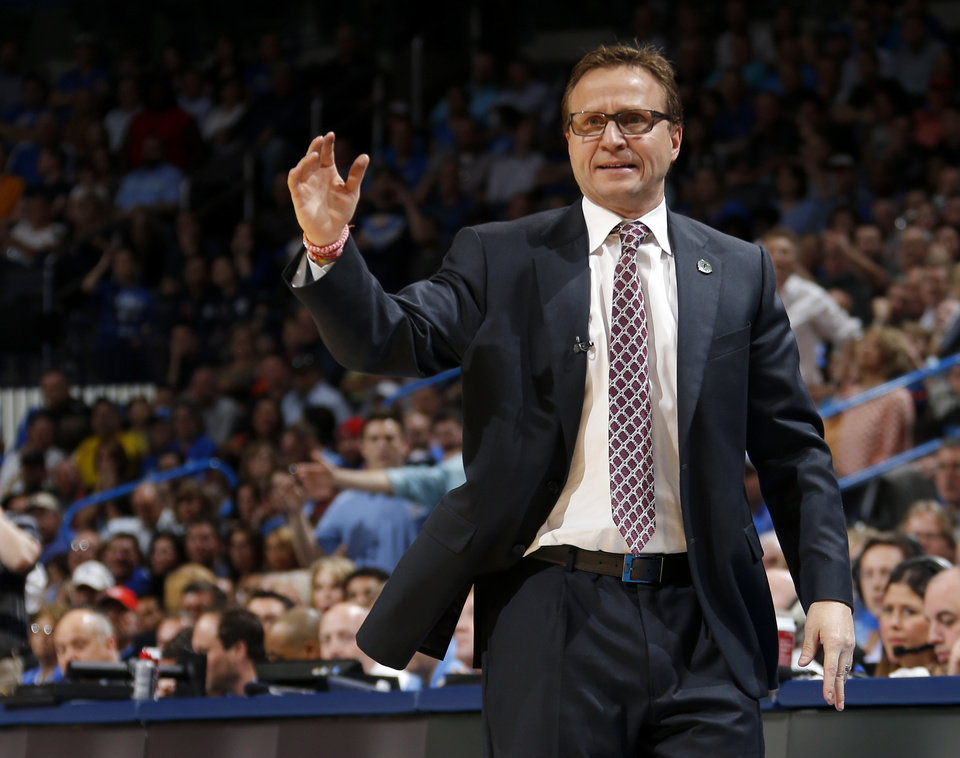 Photo - Oklahoma City coach Scott Brooks shouts towards an official during an NBA basketball game between the Oklahoma City Thunder and the San Antonio Spurs at Chesapeake Energy Arena in Oklahoma City, Thursday, April 3, 2014. Oklahoma City won 106-94. Photo by Bryan Terry, The Oklahoman