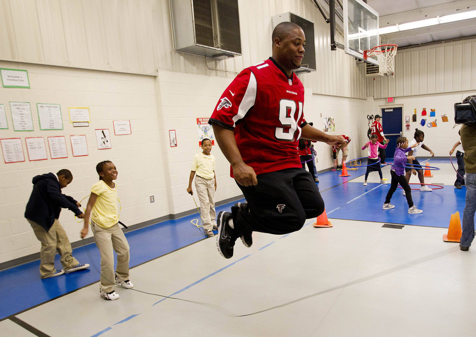 Atlanta Falcons defensive lineman Corey Peters plays with kids at Clifton elementary School as part of the NFL's Hometown Huddles program in Atlanta, Tuesday, Oct. 9, 2012. Peterson was one of several Falcons players who spent the morning visiting Atlanta-area schools to stress the importance of exercise. (AP (AP Photo/John Bazemore)