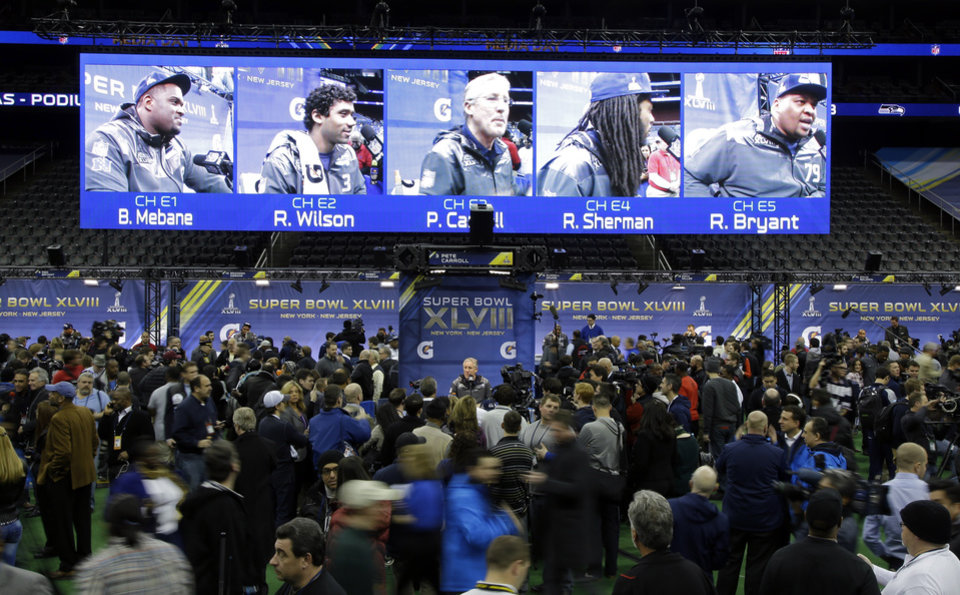 Photo - Seattle Seahawks head coach Pete Carroll speaks during media day for the NFL Super Bowl XLVIII football game Tuesday, Jan. 28, 2014, in Newark, N.J. (AP Photo/Matt Slocum)
