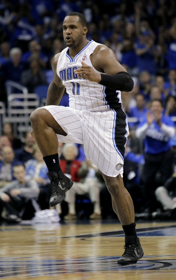 Photo -   Orlando Magic's Glen Davis jumps up and down after making a shot against the Indiana Pacers during the first half of Game 3 of an NBA first-round playoff basketball series, Wednesday, May 2, 2012, in Orlando, Fla. (AP Photo/John Raoux)
