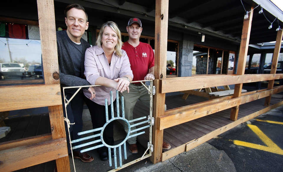Photo - Green Chili Kitchen owners Trevor Logan ,left, Tara Peters and Trent Logan pose for a photo on the patio in Yukon, Friday  January  11, 2013. Photo By Steve Gooch, The Oklahoman