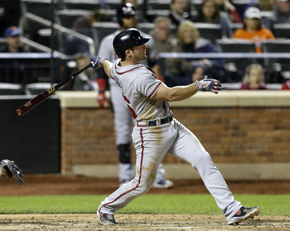 Atlanta Braves' Dan Uggla follows through on his seventh-inning, two-run home run off New York Mets starting pitcher Shaun Marcum in a baseball game at Citi Field in New York, Sunday, May 26, 2013. (AP Photo/Kathy Willens)