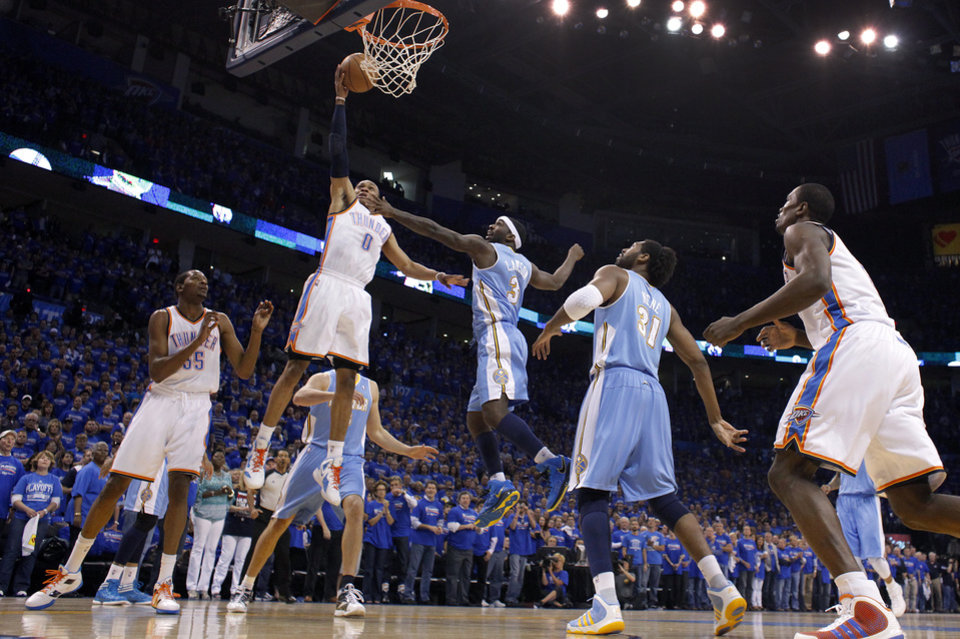 Photo - Oklahoma City's Russell Westbrook (0) puts up a shot over Denver's Ty Lawson (3) during the first round NBA playoff game between the Oklahoma City Thunder and the Denver Nuggets on Sunday, April 17, 2011, in Oklahoma City, Okla. Photo by Chris Landsberger, The Oklahoman