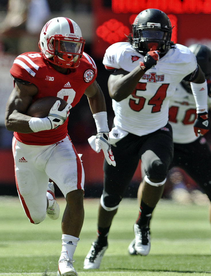 Photo -   Nebraska's Ameer Abdullah (8) runs the ball as Arkansas State's Shervarius Jackson (54) pursues during the first half of an NCAA college football game in Lincoln, Neb., Saturday, Sept. 15, 2012. (AP Photo/Dave Weaver)