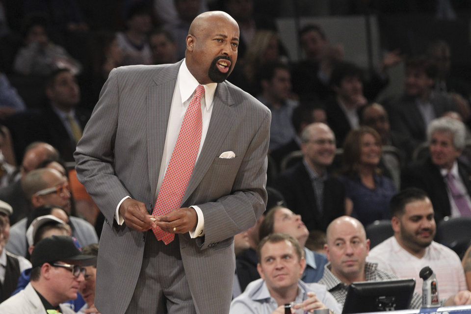 Photo - New York Knicks head coach Mike Woodson gives his team direction during the first half of an NBA basketball game against the Washington Wizards, Tuesday, April 9, 2013, at Madison Square Garden in New York. The Knicks won 120-99.  (AP Photo/Mary Altaffer)