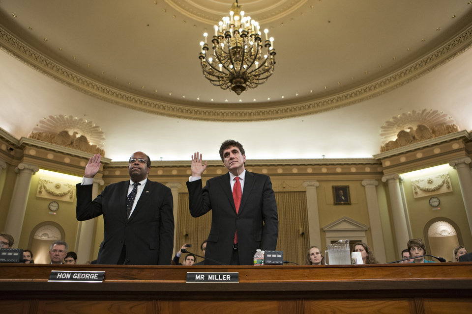Photo - Ousted IRS chief Steven Miller, right, and J. Russell George, the Treasury inspector general for tax administration, are sworn in on Capitol Hill, in Washington, Friday, May 17, 2013, prior to testifying before the House Ways and Means Committee hearing on the extra scrutiny the IRS gave Tea Party and other conservative groups that applied for tax-exempt status.  (AP Photo/J. Scott Applewhite)
