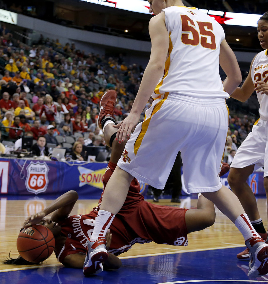 Oklahoma's Sharane Campbell (24) dives for the ball under Iowa State's Anna Prins (55) during the Big 12 tournament women's college basketball game between the University of Oklahoma and Iowa State University at American Airlines Arena in Dallas, Sunday, March 10, 2012.  Photo by Bryan Terry, The Oklahoman