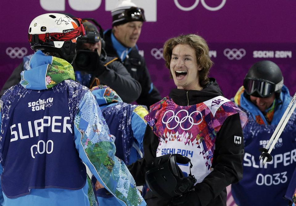 Photo - Switzerland's Iouri Podladtchikov celebrates after his half pipe run during the men's snowboard halfpipe final at the Rosa Khutor Extreme Park, at the 2014 Winter Olympics, Tuesday, Feb. 11, 2014, in Krasnaya Polyana, Russia. Podladtchikov won the gold medal. (AP Photo/Andy Wong)