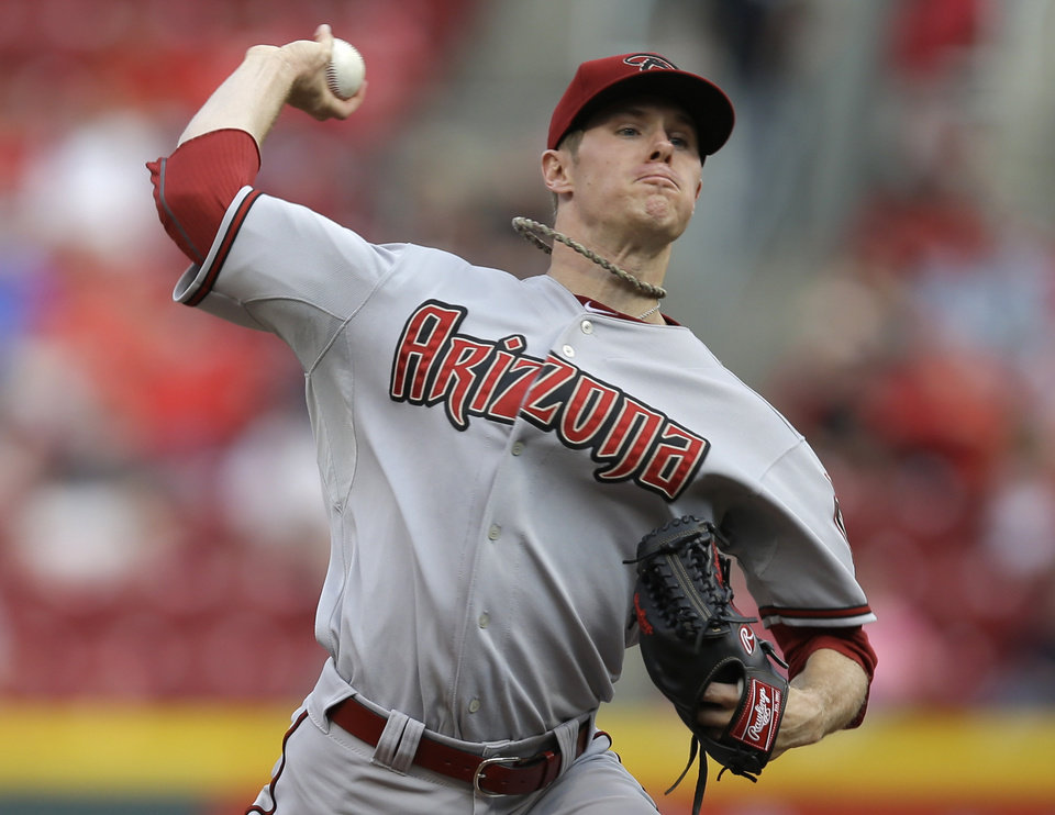 Photo - Arizona Diamondbacks starting pitcher Chase Anderson throws against the Cincinnati Reds in the first inning of a baseball game, Monday, July 28, 2014, in Cincinnati. (AP Photo/Al Behrman)