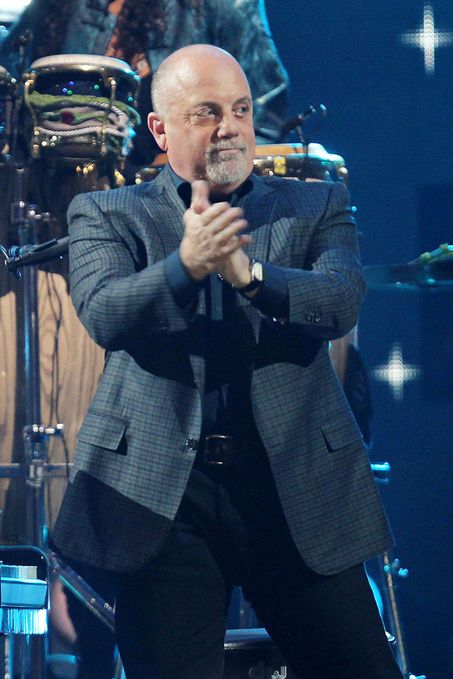 Photo - This image released by Starpix shows Billy Joel at the 12-12-12 The Concert for Sandy Relief at Madison Square Garden in New York on Wednesday, Dec. 12, 2012. Proceeds from the show will be distributed through the Robin Hood Foundation. (AP Photo/Starpix, Dave Allocca)