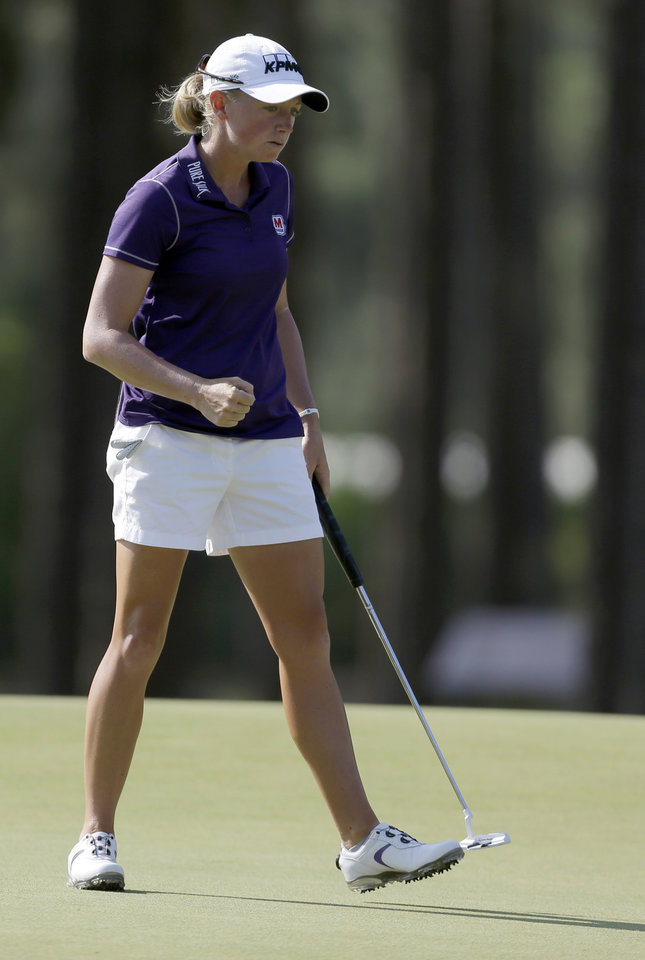 Photo - Stacy Lewis pumps her fist after making a putt on the 14th hole during the first round of the U.S. Women's Open golf tournament in Pinehurst, N.C., Thursday, June 19, 2014. (AP Photo/Bob Leverone)
