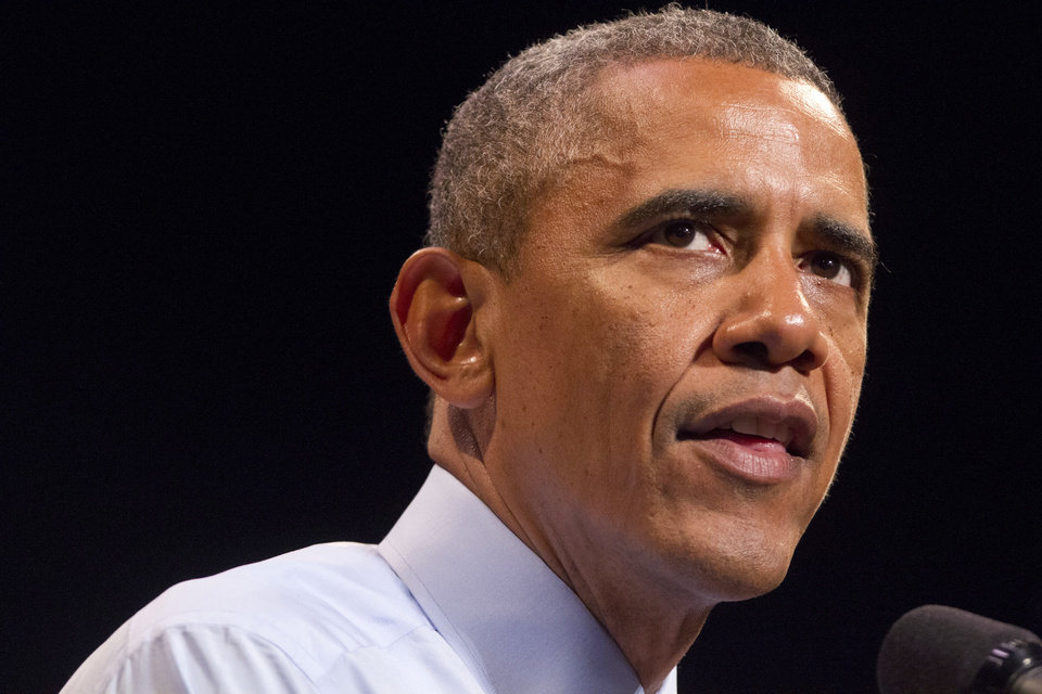 Photo - President Barack Obama speaks at the Paramount Theatre in Austin, Texas, Thursday, July 10, 2014, about the economy. Austin is the final leg in his three city trip before returning to Washington. (AP Photo/Jacquelyn Martin)