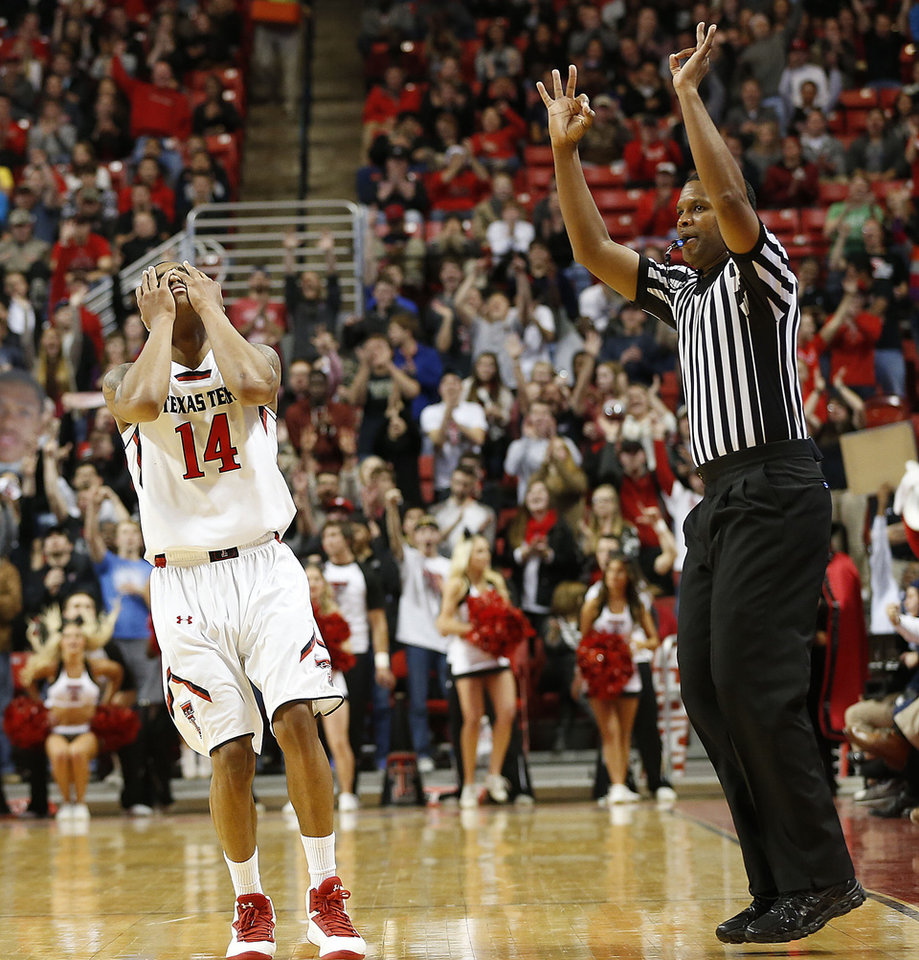 Photo - Texas Tech's Robert Turner (14) celebrates hitting a 3-point basket against Baylor during an NCAA college basketball game in Lubbock, Texas, Wednesday, Jan, 15, 2014. (AP Photo/Lubbock Avalanche-Journal, Tori Eichberger)  ALL LOCAL TV OUT