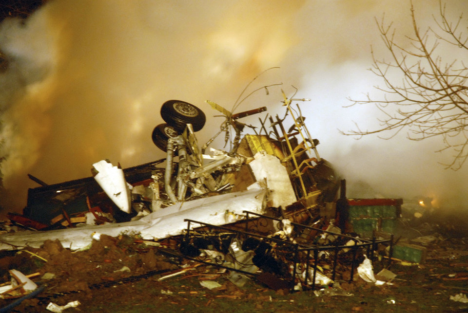 FILE - In this Feb. 12, 2009, file photo, the wreckage of Continental flight 3407 lies amid smoke at the scene after crashing into a suburban Buffalo home and erupting into flames, killing all 48 people aboard and at least one person on the ground, according to authorities. Faced with substantial industry opposition, federal regulators are struggling to implement a sweeping aviation safety law enacted in the wake of the last fatal U.S. airline crash nearly four years ago, according to a report by a government watchdog. The Federal Aviation Administration is experiencing lengthy delays in putting in place rules required by the law to increase the amount of experience necessary to be an airline pilot, provide more realistic pilot training and create a program where experienced captains mentor less experienced first officers, according to the report by the Department of Transportation�s Inspector General. (AP Photo/Dave Sherman, File)