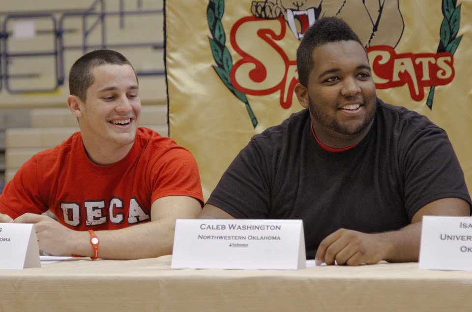 NATIONAL SIGNING DAY / SIGN / SIGNED: Southmoore High School's Levi Jennings and Caleb Washington, from left, laught after signing his letter of intent to play football at the Northwestern Oklahoma during National Signing Day at Southmoore High School on Wednesday, Feb. 1, 2012, in Oklahoma City, Okla. Photo by Chris Landsberger, The Oklahoman
