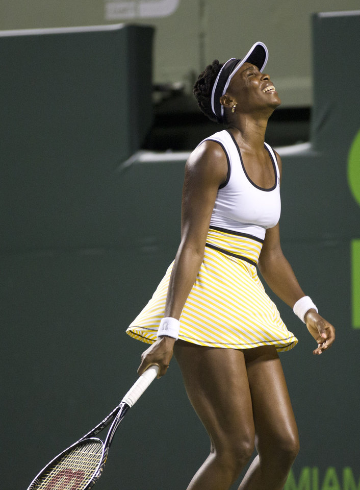 Photo - Venus Williams, of the United States, reacts after losing a game to  Dominika Cibulkova, of Slovakia, during the Sony Open Tennis in Key Biscayne, Fla., Monday, March 24, 2014. (AP Photo/J Pat Carter)