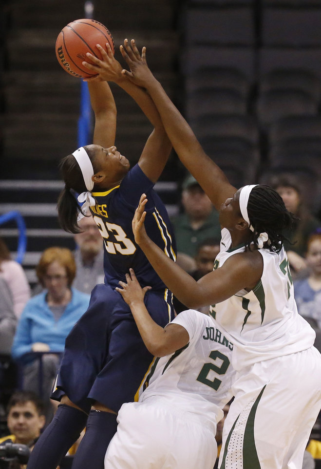 Photo - West Virginia guard Bria Holmes (23) shoots over Baylor guard Niya Johnson (2) and point Sune Agbuke (22) in the first half of an NCAA college basketball game in the finals of the Big 12 Conference women's college tournament in Oklahoma City, Monday, March 10, 2014. (AP Photo/Sue Ogrocki)