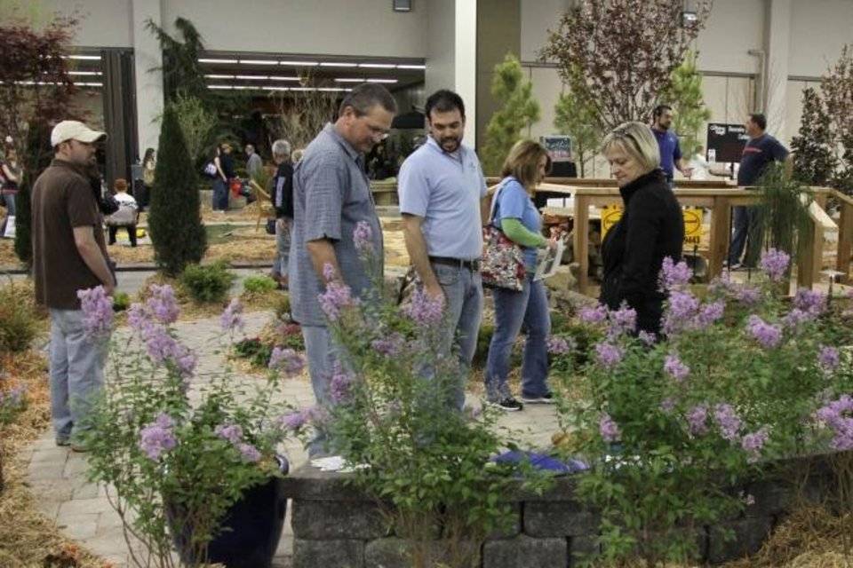 Photo -  Men look at landscape plants at a previous Oklahoma City Spring Remodel & Landscape Show. The next show is scheduled for Jan. 29-31 at The Pavilion at the OKC Fairgrounds. [PHOTO PROVIDED/L&L MANAGEMENT INC.]