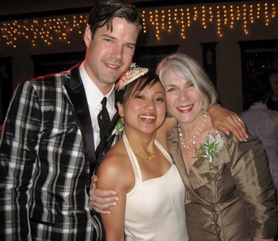 WEDDING RECEPTION...Matt Seikel, Denise Duong and Jeary Seikel.  (Photo by Helen Ford Wallace).